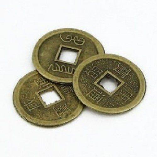 Приметы о монетах с дырочкой